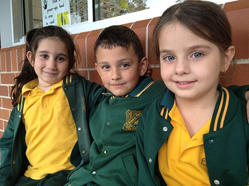 Bossley Park Public School - 2 girls and a boy sitting down